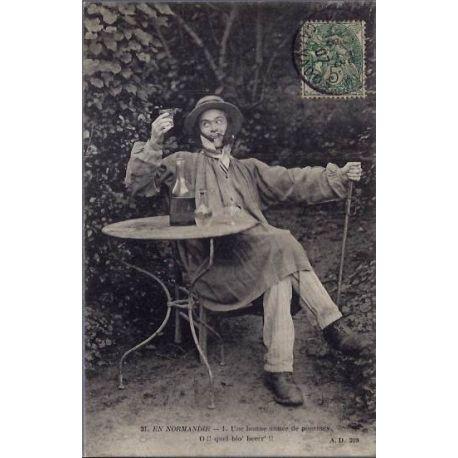 14 - En Normandie - un homme assis autour d'une table -Une bonne annee de pomm