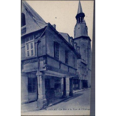 22 - Dinan - la rue et la tour de l' Horloge - Non voyage - Dos divise...