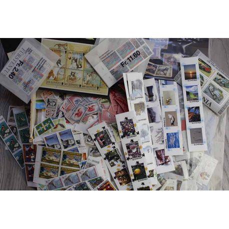 Gros vrac de timbres du monde neufs et oblitérés